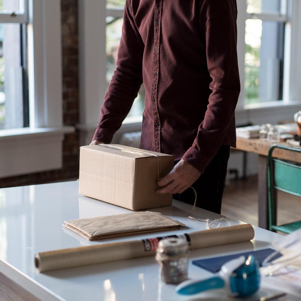 person folding box