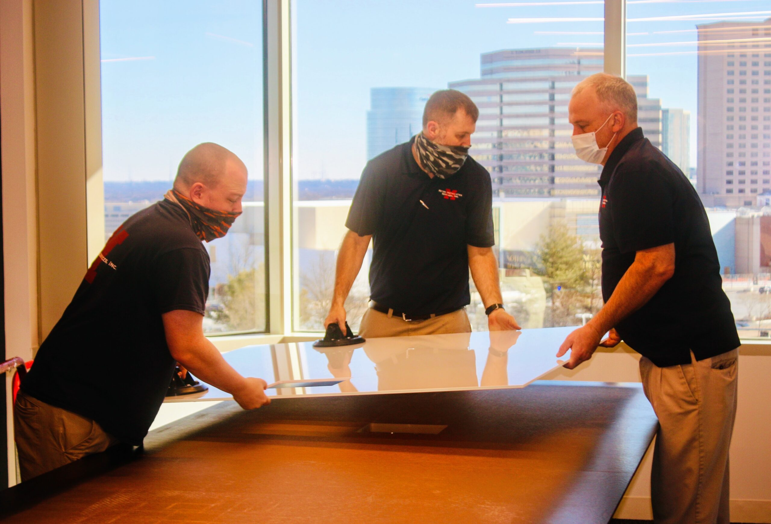 Metro installers assemble conference table